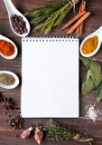 Fresh herbs, different spices notebook on the table Stock Images
