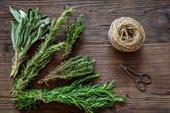 Fresh herbs and greenery for spices and cooking on wooden desk background top view Stock Photo