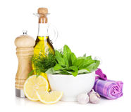 Fresh herbs, olive oil and pepper shaker Royalty Free Stock Photo