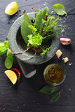Fresh herbs in a pestle and mortar Stock Image