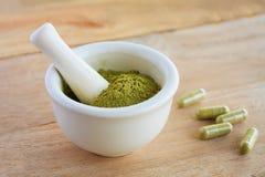 Fresh herbs powder in the mortar stock photos