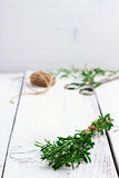 Fresh herbs (savory) on a wooden table Royalty Free Stock Image