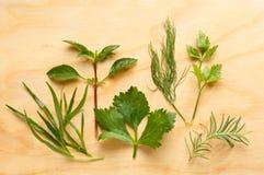 Fresh Herbs Seasoning Mix On Chopping Board Stock Photography