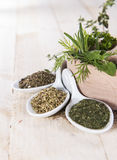 Fresh herbs in a small wooden bowl Stock Photo