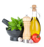 Fresh herbs, spices, olive oil and pepper shaker Stock Image