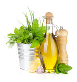 Fresh herbs, spices, olive oil and pepper shaker Stock Photo