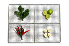 Fresh herbs and spices in a stainless plate on white background, Ingredients of Thai spicy food Tom Yum Stock Photo
