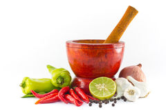 Fresh herbs and spices with wooden mortar. On white background Stock Images