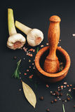 Fresh herbs and spices in wooden mortar Stock Photo