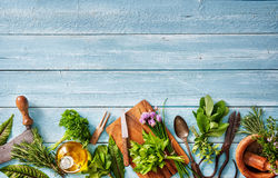 Fresh herbs and spices on wooden table Royalty Free Stock Images