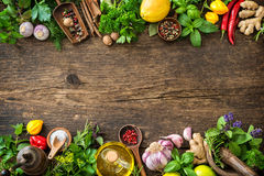Fresh herbs and spices on wooden table. Top view with copy space royalty free stock photography