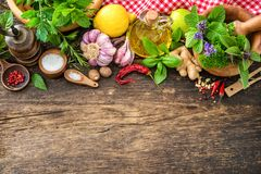 Fresh herbs and spices on wooden table. Top view with copy space stock photography