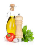 Fresh herbs, tomato, olive oil and pepper shaker Royalty Free Stock Photography