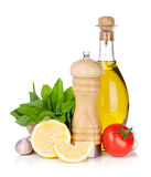Fresh herbs, tomato, olive oil and pepper shaker Stock Images
