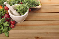 Fresh herbs and vegetables with a mortar and pestle Stock Image