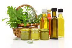 Fresh herbs in wicker basket. And natural cosmetics royalty free stock images