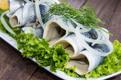 Fresh Herring Filet on a plate. Against wooden background Stock Image