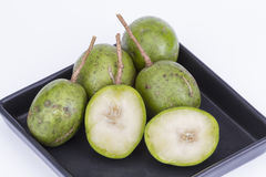 Fresh Hog plum (Wild Mango) on black dish Stock Images