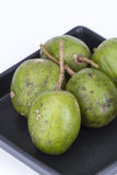 Fresh Hog plum (Wild Mango) on black dish Stock Image