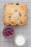 Fresh home baked scone with jam and clotted cream Royalty Free Stock Image