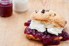 Fresh home baked scone with jam and clotted cream Royalty Free Stock Photography