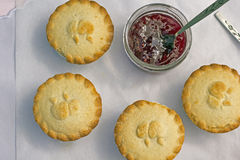Fresh home made apple pies with raspberry jam. On the table Stock Image