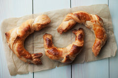 Fresh home made croissants. On wooden table Royalty Free Stock Photography