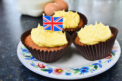 Fresh home made cupcakes. Fresh home made lemon drizzle cupcakes with the Union Jack flag denoting typical british fayre Stock Images