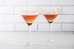 Fresh home made Manhattan cocktails with garnish Royalty Free Stock Images