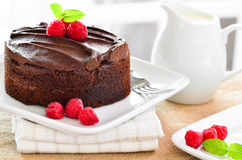 Fresh home made sticky chocolate fudge cake with raspberries Stock Photos