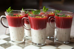 Fresh home made strawberry yoghurt dessert. With pepermint leaf Royalty Free Stock Images
