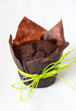 Chocolate muffin. Fresh homebaked chocolate muffin on a white linen background Stock Photo