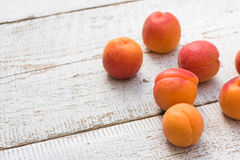 Fresh homegrown apricots on vintage white wooden table Stock Images