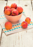Fresh homegrown apricots on vintage white wooden table Royalty Free Stock Photo