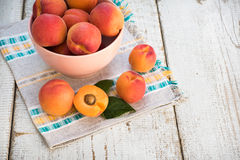 Fresh homegrown apricots on vintage white wooden table Stock Image