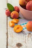 Fresh homegrown apricots on vintage white wooden table Royalty Free Stock Photos