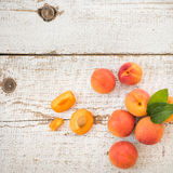 Fresh homegrown apricots on vintage white wooden table Stock Photos