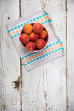 Fresh homegrown apricots on vintage white wooden table Stock Photography
