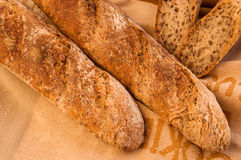 Fresh homemade Alpine Baguettes with seeds and cereal flakes. Royalty Free Stock Photos