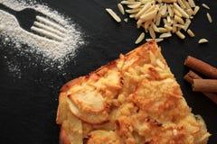 Fresh homemade apple pie top view on black background Stock Photos