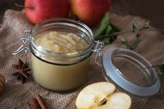 Fresh homemade applesauce with apples. On a wooden table Stock Photos