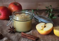 Fresh homemade applesauce with apples. On a wooden table Royalty Free Stock Photos