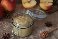 Fresh homemade applesauce with apples. On a wooden table Stock Photo