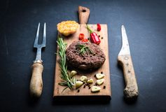 Fresh homemade beef burger cutlet on cooking board Royalty Free Stock Photo