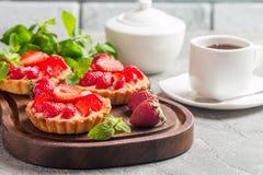 Fresh homemade berrie tarts. Fresh homemade strawberries tarts on gray background royalty free stock image