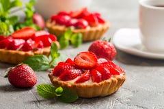 Fresh homemade berrie tarts. Fresh homemade strawberries tarts on gray background stock images