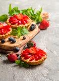 Fresh homemade berrie tarts. Fresh homemade strawberries tarts on gray background stock photo