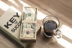 Fresh homemade black coffee and dollar in breakfast. royalty free stock photo