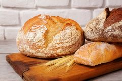Fresh Homemade Bread Assortment On Old Cutting Board Royalty Free Stock Images