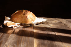 Fresh homemade bread on the dark wooden background. Stock Images